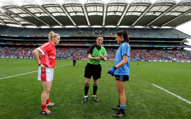 sinead-goldrick-and-briege-corkery-with-referee-maggie-farrelly-at-the-coin-toss