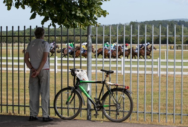 locals-watch-the-first-race-from-outside-naas-racecourse-as-racing-in-ireland-resumes