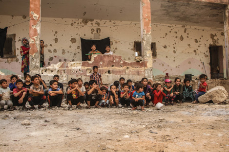 a-theatrical-show-for-displaced-children-at-a-destroyed-school