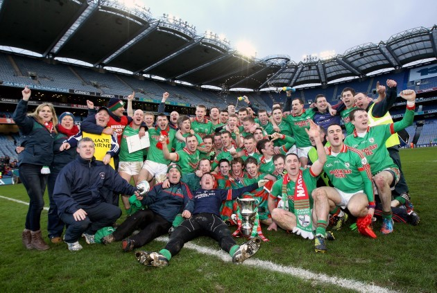 st-brigids-team-celebrate-with-the-trophy