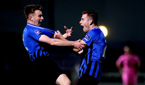 adam-lennon-celebrates-scoring-his-sides-fifth-goal-with-jack-reynolds