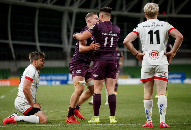 louis-ludik-and-rob-lyttle-dejected-as-scott-penny-celebrates-his-try-with-cian-kelleher