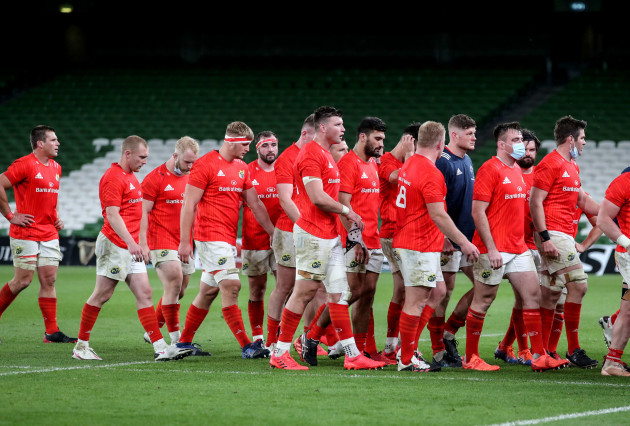 the-munster-team-leave-the-field-dejected