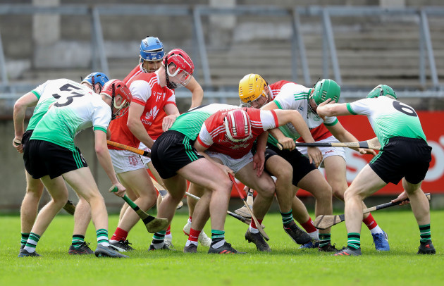 lucan-sarsfields-and-cuala-players-struggle-to-win-a-loose-ball