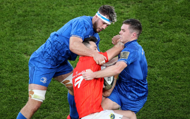 conor-murray-is-tackled-by-caelan-doris-and-luke-mcgrath