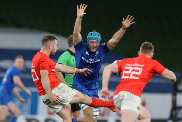 leinsters-will-connors-tries-to-charge-down-munsters-jj-hanrahan