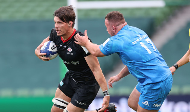 saracens-mike-rhodes-is-tackled-by-leinsters-ed-byrne