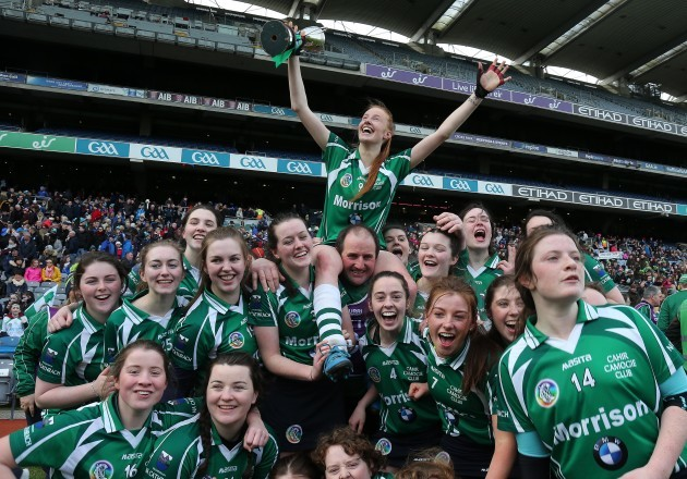 cahir-team-celebrate-with-player-of-the-game-aishling-moloney-lifted-shoulder-high