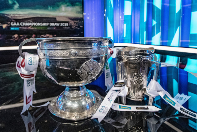 a-general-view-of-the-sam-maguire-and-liam-maccarthy-cups-ahead-of-the-draw