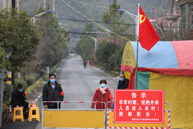 china-wuhan-coronavirus-emergency-volunteers-guard-a-visitor-checkpoint-at-the-entrance-to-a-village-in-hangzhou-in-east-chinas-zhejiang-province