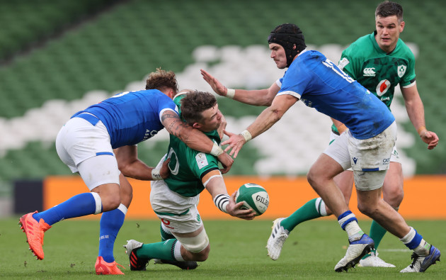 irelands-peter-omahony-is-tackled-by-italys-federico-mori-and-carlo-canna