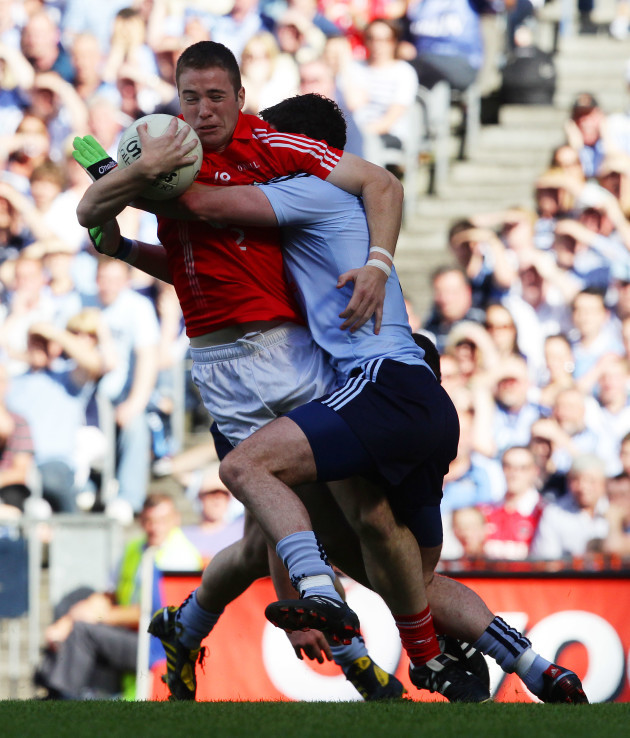 colm-oneill-is-tackled-by-ross-mcconnell