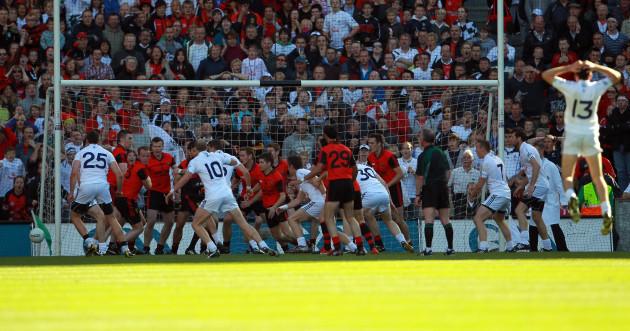 the-down-team-scramble-the-ball-away-as-robert-kelly