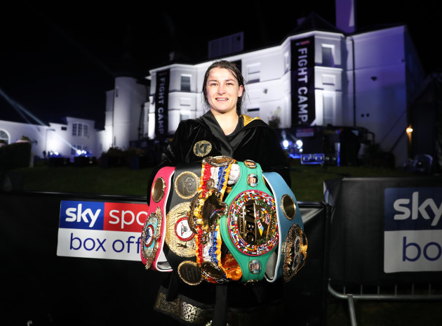 katie-taylor-with-her-titles-after-winning