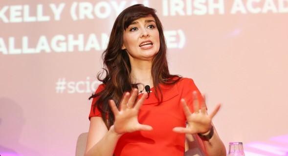 Aoibhinn Ní Shúilleabháin speaking at a conference