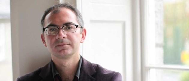 Prof Michael Doherty headshot beside a window