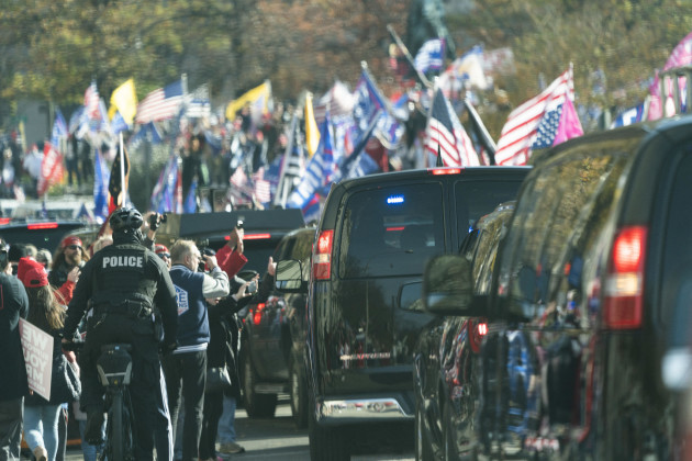 the-motorcade-carrying-u-s-president-donald-j-trump-drives-through-a-rally-of-trump-supporters