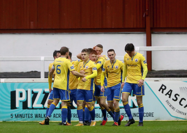 rob-manley-celebrates-scoring-a-goal-with-team-mates