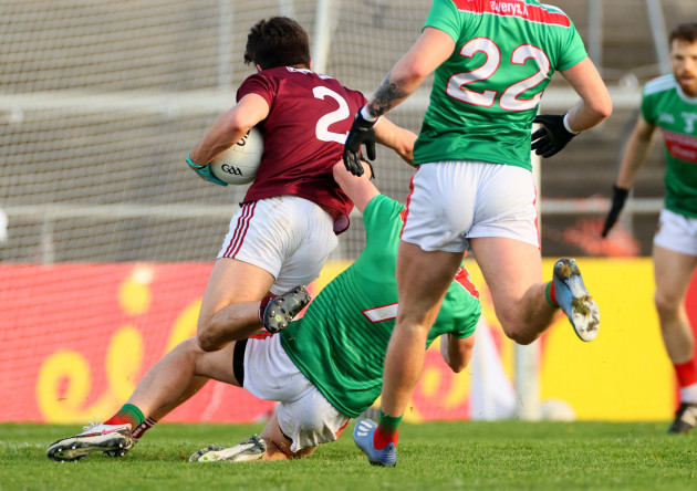 sean-kelly-is-tackled-by-eoghan-mclaughlin