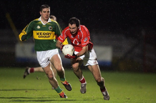 dermot-hurley-of-cork-is-tackled-by-darragh-ose-of-kerry-1122006
