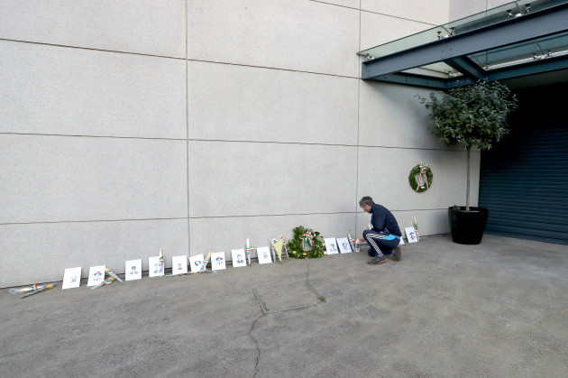 tom-broughan-lights-a-candle-outside-the-memorial-to-the-14-victims-of-bloody-sunday-on-jones-road-ahead-of-the-gaa-bloody-sunday-commemoration-at-croke-park