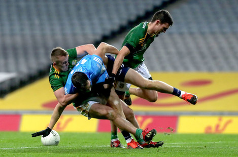 dean-rock-is-tackled-by-ronan-ryan-and-shane-mcentee