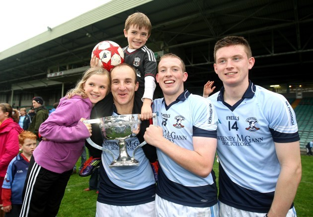 damien-quigley-with-his-children-emma-and-colm-celebrate-with-shane-dowling-and-kevin-downes