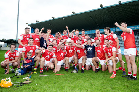 cuala-players-celebrate-with-the-trophy