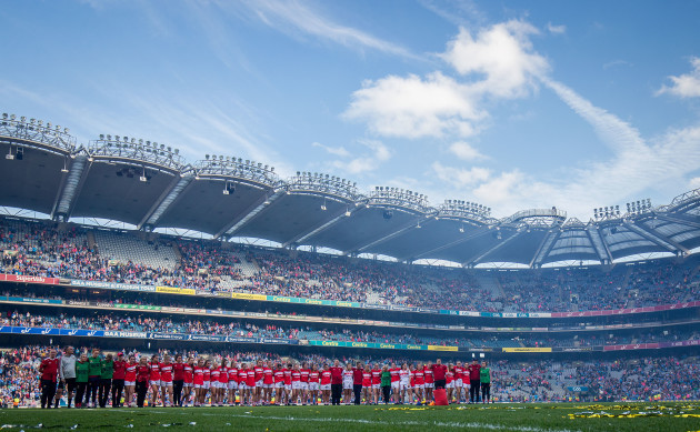 the-cork-team-stand-during-the-trophy-presentation