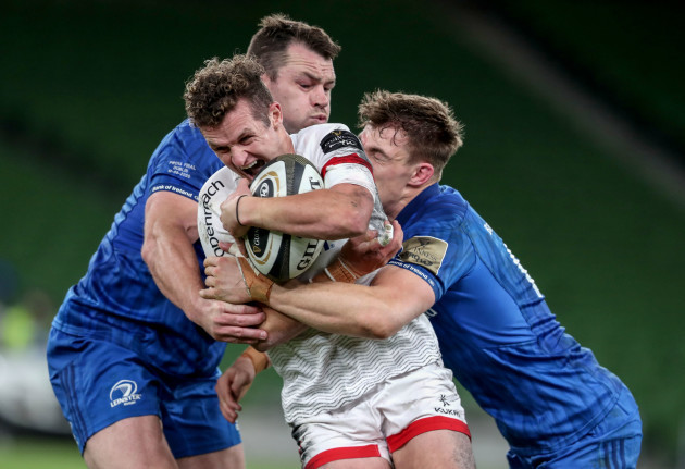 billy-burns-is-tackled-by-cian-healy-and-garry-ringrose