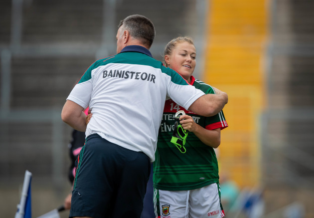 peter-leahy-hugs-sarah-rowe-as-she-comes-off-the-pitch