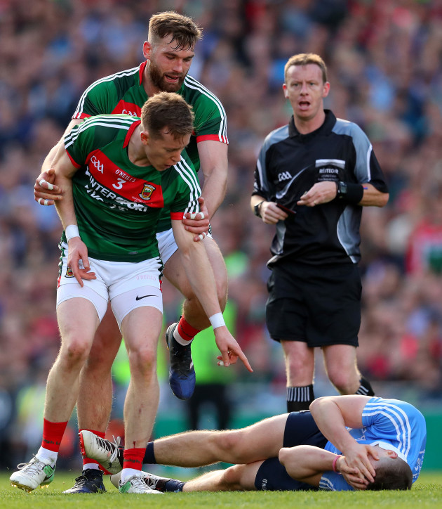 donal-vaughan-points-at-john-small-following-a-challenge-that-resulted-in-a-red-card