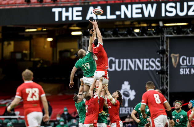 iain-henderson-competes-in-the-air-with-adam-beard