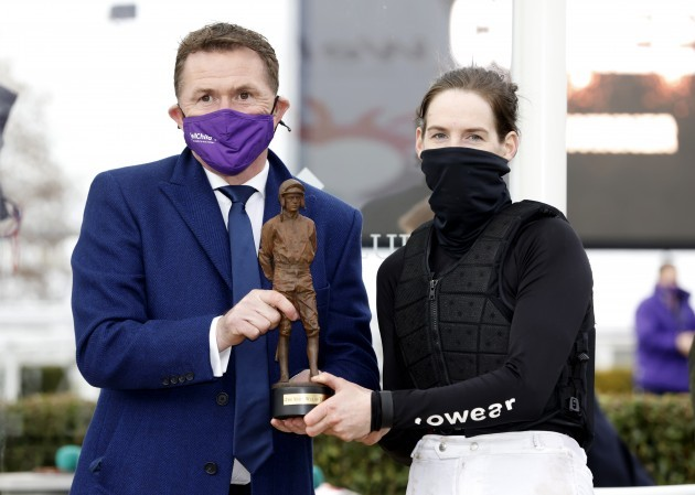 rachael-blackmore-is-presented-with-the-top-jockey-award-the-ruby-walsh-trophy-by-sir-a-p-mccoy