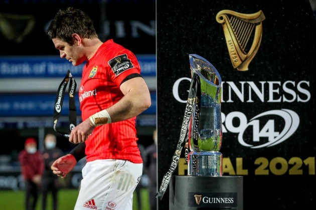 billy-holland-dejected-walking-past-the-guinness-pro14-trophy