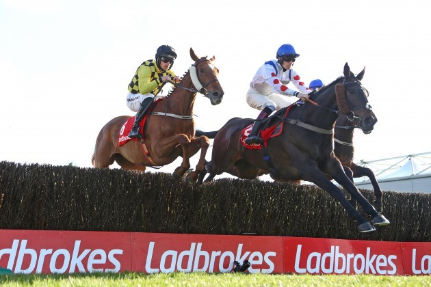 sam-twiston-davies-on-clan-des-obeaux-jumps-ahead-of-patrick-mullins-on-melon-during-the-race