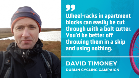 David Timoney - Wheel-racks in apartment blocks can easily be cut through with a bolt cutter. You'd be better off throwing them in a skip and using nothing.