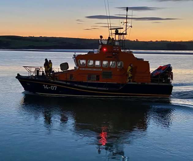 Courtmacsherry RNLI Lifeboat arriving into Courtmacsherry at dawn this morning with the four rescued on board.