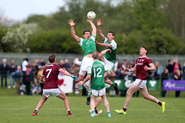 anthony-mcdermott-and-liam-feerick-compete-for-an-aerial-ball