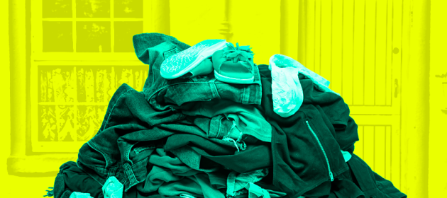 Pile of discarded clothes with window and door in the background