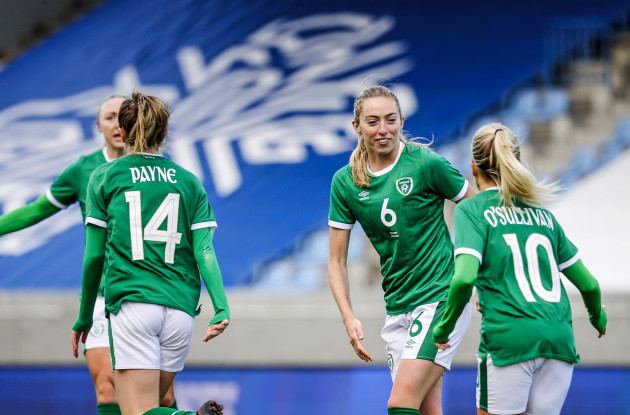 heather-payne-celebrates-with-megan-connolly-and-denise-osullivan-after-scoring-a-goal