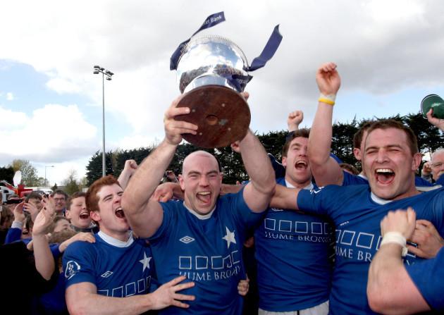 hugh-hogan-lifts-the-trophy