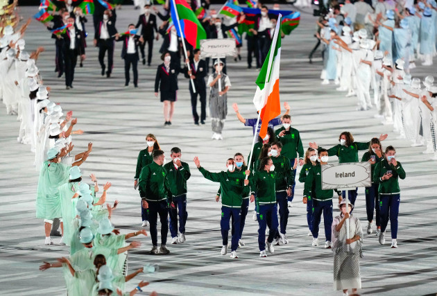 kellie-harrington-and-brendan-irvine-lead-team-ireland-while-holding-the-tricolour