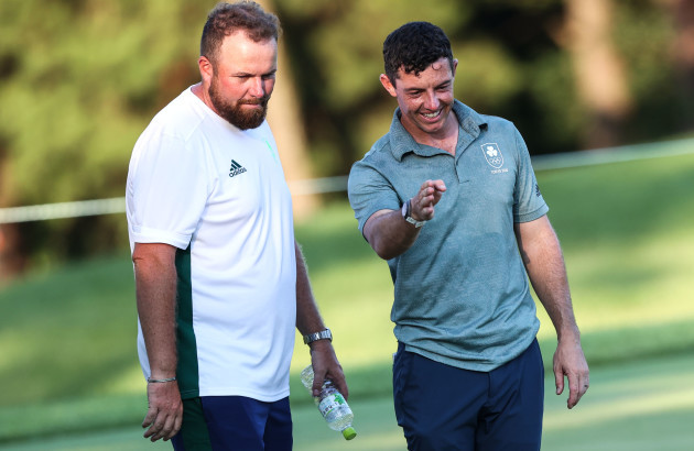 rory-mcilroy-with-shane-lowry-moments-after-missing-a-putt-to-get-knocked-out-of-the-bronze-medal-play-off