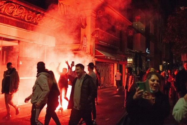 melbourne-australia-5th-august-2021-anti-lockdown-protesters-illuminated-by-the-light-from-a-phosphorus-flare-unhappy-at-the-recent-announcement-that-victorias-sixth-lockdown-would-commence-later