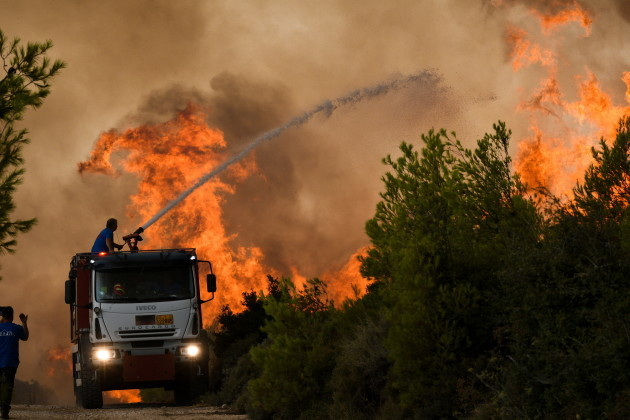 Forest fires rage near Athens Greece