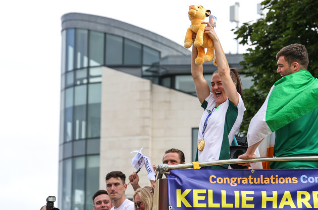 kellie-harrington-raises-a-plush-simba-to-the-crowd-in-reference-to-her-use-of-the-phrase-hakuna-matata