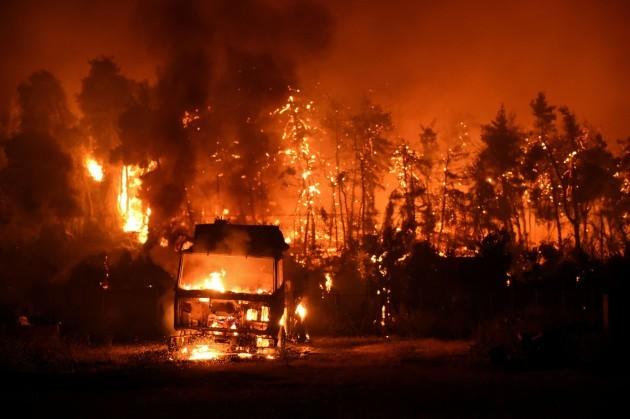 a-wildfire-burns-in-the-village-of-vasilika-on-evia-island-greece-august-7-2021-picture-taken-august-7-2021-reutersalexandros-avramidis
