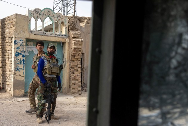 members-of-afghan-special-forces-regroup-after-heavy-clashes-with-taliban-during-the-rescue-mission-of-a-policeman-besieged-at-a-check-post-in-kandahar-province-afghanistan-july-13-2021-reutersd