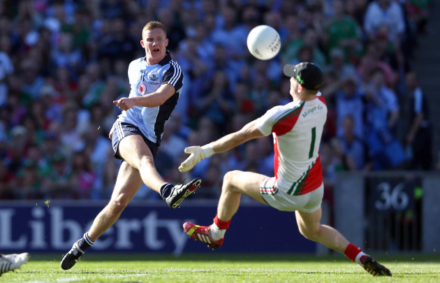 ciaran-kilkenny-has-a-shot-saved-by-robert-hennelly